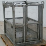 Crane suspended stainless steel personnel cages.